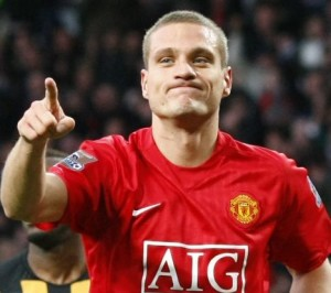 Manchester United's Vidic celebrates after scoring during their English Premier League soccer match against Hull City in Manchester